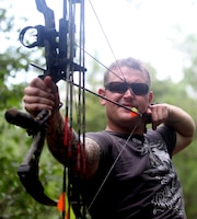 Sgt. Cameron Greenwood, a Marine with Marine Special Operations Command, takes aim at a 3-D foam bear during the Frogman 3-D Bowhunters Challenge Aug. 18. Greenwood was there to take part in an activity he enjoys, archery, while supporting wounded warriors and honoring the memory of fallen Navy SEAL, Chief Petty Officer Chris Campbell.