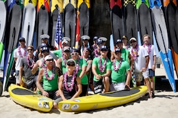 The Wounded Warrior Battalion-West paddle board team and supporters pose for group photographs to be taken after finishing the Catalina Classic at the Manhattan Beach Pier on Manhattan Beach, Ca., Aug. 26.