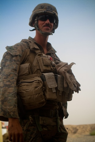 Lance Cpl. Jacob Noremberg, pointman, Weapons Company, 1st Battalion, 1st Marines, Regimental Combat Team 6, prepares to patrol, Aug. 26, 2012. Noremberg was shot in the side Small Arms Protective Insert plate, while he was in Trek Nawa, the area between the Marjah and Nawa districts, a month ago.