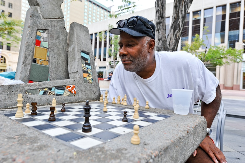 DENVER – A chess player ponders his next move during a chess match Aug. 24, 2012. Several chess and checkers tables are located throughout 16th Street downtown. Bring your own pieces as they are not provided. (U.S. Air Force photo by Senior Airman Christopher Gross)