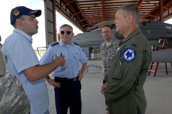 Col. Mike Hudson, 169th Fighter Wing Commander at McEntire Joint National Guard Base, S.C., speaks with members of a Colombian delegation during their tour of base facilities July 24, 2012. The visit occurred one day after announcing the State Partnership between South Carolina and the Republic of Colombia. The historic bilateral partnership will promote mutual capabilities, national security objectives and long term stability.