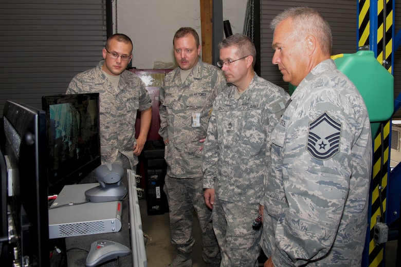 Staff Sgt. Robert Nine,  Tech. Sgt. Brandt Roach and members of the 169th Communications Flight work with personnel from the S.C. Army National Guard on the latest Joint Incident  Site Communication Capability package delivered to McEntire.
