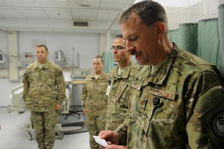 Maj. Bryan Wright reads the citation for the Purple Heart Medal during a ceremony at the Craig Joint Theater Hospital, Bagram Airfield, Afghanistan.  Since he arrived in March, Wright said he has presided at 15 such ceremonies for CJSOTF personnel.