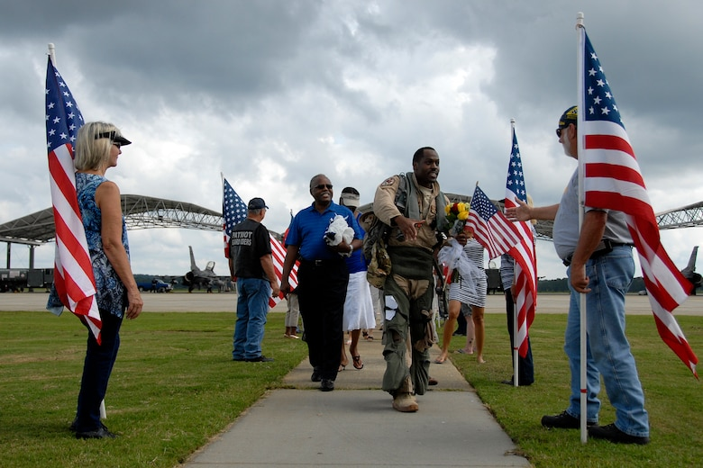 """Maj. Taj """"Kong"""" Troy, an F-16 Fighting Falcon fighter pilot with the 157th Fighter Squadron at McEntire Joint National Guard Base, S.C., returns home to a hero's welcome after a four-month Air Expeditionary Force deployment at Kandahar Airfield, Afghanistan, Aug. 23, 2012. Swamp Fox F-16's, pilots, and support personnel began their AEF deployment in support of Operation Enduring Freedom in early April to take over flying missions for the air tasking order and provide close air support for troops on the ground in Afghanistan."""