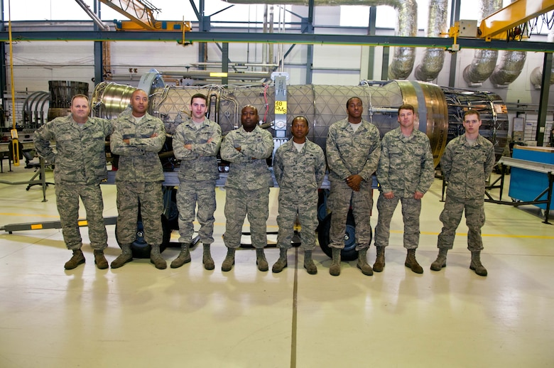 Master Sgt. James Compton, Tech. Sgt. Corwyn Goodman, Senior Airman Dakota Havel, Tech. Sgt. Orlando Harris, Tech. Sgt. Clintwan Cooper, Senior Airman Justin White , Staff Sgt. Charles Warfle, Airman 1st Class Jesse Summerlin, aerospace propulsion maintainers from the 169th Fighter Wing, McEntire Joint National Guard Base, S.C., pose for a photo inside the 48th Component Maintenance Squadron hangar August 2, 2012. The 169th FW maintainers are here in support of their unit, which is currently deployed to Afghanistan. (U.S. Air Force photo by Senior Airman Connor Estes)