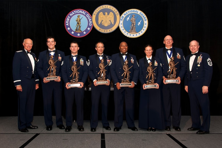 The 2012 Air National Guard Airmen of the Year pose for a photo during the 2012 Soldiers and Airmen of the Year banquet at the Sheraton Pentagon City, Arlington, Va 24, Aug 2012. Pictured are (left to right) Lt. Gen. Harry M. Wyatt III, the director of the ANG, Airman of the Year: Senior Airman Michael D. McCaffrey, 116th Air Refueling Wing, Washington ANG, Noncommissioned Officer of the Year: Tech. Sgt. Jacob S. Curtis, 126th Air Refueling Wing, Illinois ANG, Senior Noncommissioned Officer of the Year: Senior Master Sgt. Luke W. Thompson, 125th Special Tactics Squadron, Oregon ANG, First Sergeant of the Year: Master Sgt. Fred W. Hudgins Jr., 161st Air Refueling Wing, Arizona ANG, Honor Guard Member of the Year: Staff Sgt. Carrie M. Kline, 122nd Fighter Wing, Indiana ANG, Honor Guard Program Manager of the Year: Master Sgt. Jeffrey L. Lamarche, Eastern Air Defense Sector, New York ANG, and Chief Master Sgt. Christopher Muncy, the command chief master sergeant to the director of the ANG. (National Guard photo by Master Sgt. Marvin Preston/RELEASED)