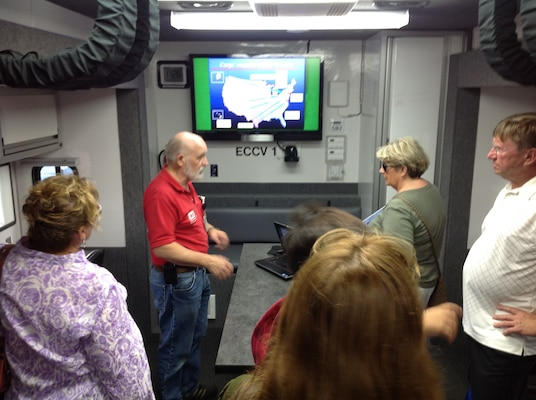 Alex Watt, a first responder licensed to drive the District's new Emergency Command and Control Vehicle, describes equipment in the vehicle and how the Corps responds to natural disasters during the Dana Point Emergency Preparedness Expo held Aug. 25.