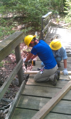 Volunteers from the Student Conservation Association work on the Overlook Trail at Tenkiller Ferry Lake.
