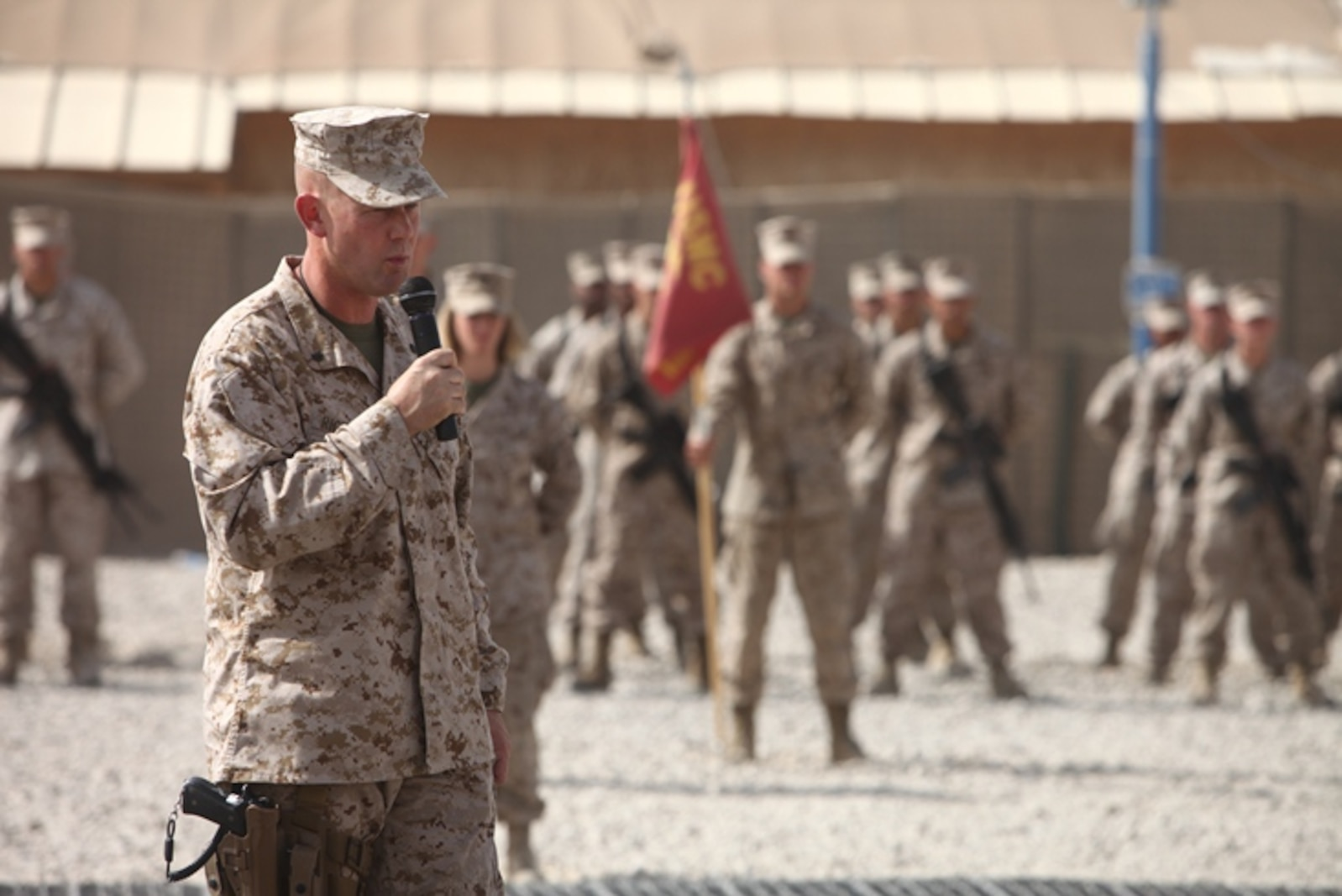 """Lt. Col. Christian Richardson, commanding officer, 1st Maintenance Battalion (-) Reinforced, 1st Marine Logistics Group (Forward) speaks to members and guests during a color casing ceremony at Camp Leatherneck, Afghanistan, Aug. 23. """"Being able to take on this challenging mission of providing tactical logistics support throughout the battle space has been absolutely tremendous,"""" said Richardson."""