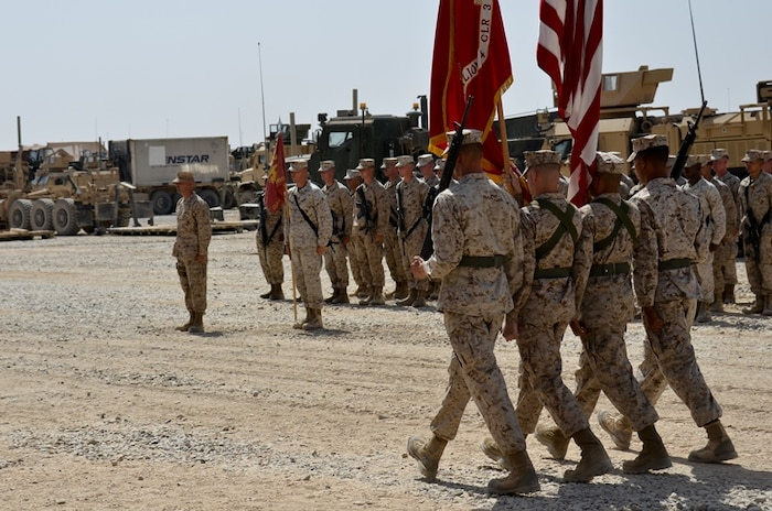 The Combat Logistics Battalion 4, 1st Marine Logistics Group (Forward) color guard marches on the colors at the transfer of authority ceremony here Aug. 14. CLB-4 transferred responsibilities as the Regimental Combat Team 6 direct support battalion to CLB-2, 1st MLG (Fwd) during the ceremony.