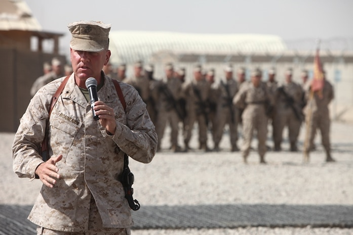 """Brig. Gen. John J. Broadmeadow, Commanding General, 1st Marine Logistics Group (Forward) speaks to members and guests of the 8th Engineer Support Battalion color casing ceremony at Camp Leatherneck, Afghanistan, Aug. 15.""""As you built village stability platforms throughout the battle space, as you realigned our bases out there, and expanded places like [Combat Outpost] Ertoba and helped to [demilitarize] places like [Forward Operating Base] Edinburgh, those are the missions that characterized this battalion,"""" said Brig. Gen. Broadmeadow."""