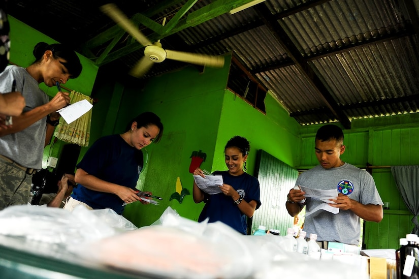 Air Force Tech. Sgt. Jennifer Nieves, Medical Element NCO in charge of Laboratory Services and Staff Sgt. Thoney Douangnoy, NCO in charge of MEDEL's pharmacy, work together with members of Costa Rica's Social Services to deliver prescription medicine to local patients. Together with Costa Rica's Ministry of Health and Social Services, JTF-Bravo delivered medical care to 704 patients during a two-day joint Medical Readiness Training Exercise.