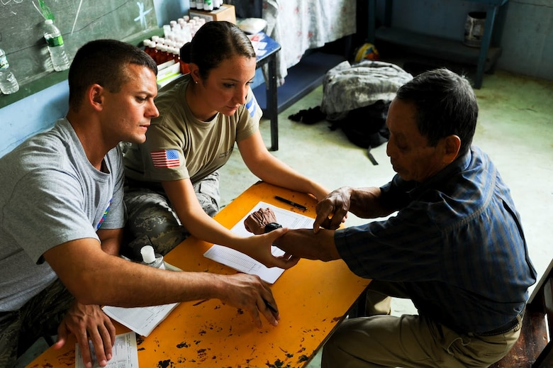 Senior Airman Maria Abello, Army Forces Battalion training NCO, listens to a Costa Rican patient explain his ailments in order to translate for Emergency Medical Technician Staff Sgt. Michael Canfield during a joint Medical Readiness Training Exercise. Together with Costa Rica's Ministry of Health and Social Services, JTF-Bravo delivered medical care to 704 patients in the Costa Rican villages of San Juan and Damitas.  (U.S. Air Force photo/1st Lt. Christopher Diaz)