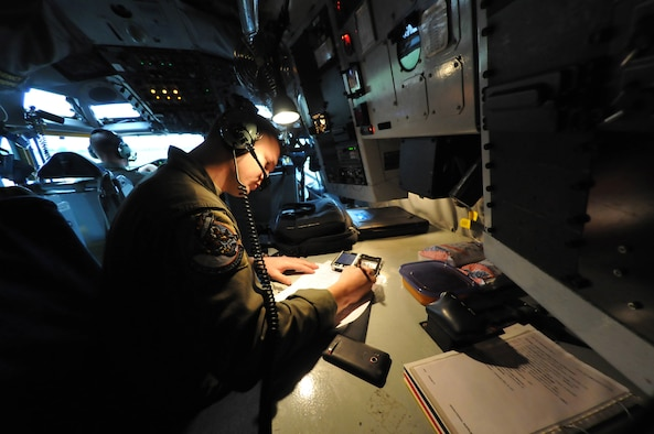 Staff Sgt. Jameson Liggett, a Boom Operator assigned to the 108th Air Refueling Squadron at Scott AFB, Ill., completes fuel calculations prior to an aerial refueling mission.  Aerial refueling extends aircraft range and mission duration subsequently providing air superiority over areas of operation.  The 108 ARS is assigned to the 126th Air Refueling Wing, Illinois Air National Guard, and routinely performs aerial refueling for U.S. Armed Forces and NATO allied aircraft. (National Guard photo by Master Sgt. Ken Stephens/Released)