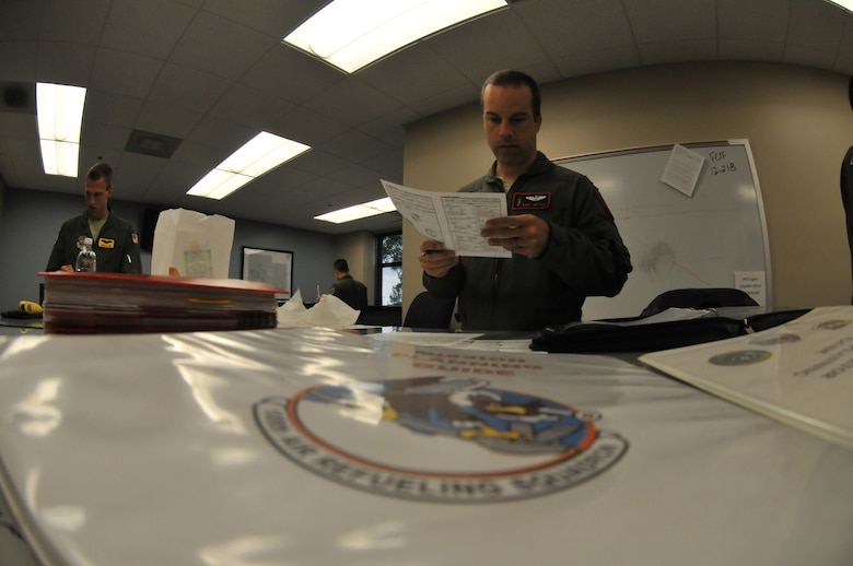 Maj. Andy Meyer, a KC-135R Stratotanker Pilot with the 108th Air Refueling Squadron, reviews his flight plan at Scott AFB, Ill., prior to an aerial refueling mission.  The aircrews of the 108 ARS, assigned to the 126th Air Refueling Wing, Illinois Air National Guard, regularly practice mid-air refueling with other U.S. Armed Forces and NATO aircraft to maintain proficiency. (National Guard photo by Master Sgt. Ken Stephens/Released)