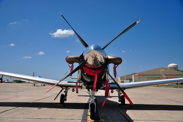 A T-6 Texan II from the 479th Flying Training Group at Naval Air Station Pensacola, Fla., sits on the south ramp at Joint Base San Antonio-Randolph, Texas, August 28, 2012. The 479th FTG is a geographically separated unit of the 12th Flying Training Wing and hosts Combat Systems Officer training for the U.S. Air Force. The 479th FTG flew 33 aircraft to Randolph in anticipation of Tropical Storm Isaac. (U.S. Air Force Photo by 2nd Lt. Keenan D. Kunst)