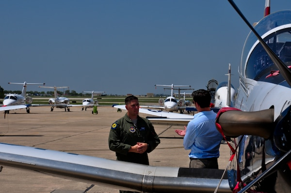 Lt. Col. Stitzel, 455th Flying Training Squadron director of operations, talks with Phil Anaya, KENS5 anchor and reporter, about the evacuation of aircraft from Naval Air Station Pensacola, Fla. to Joint Base San Antonio-Randolph,Texas, in preparation for Tropical Storm Isaac's landfall. (U.S. Air Force photo by 2nd Lt. Keenan Kunst)