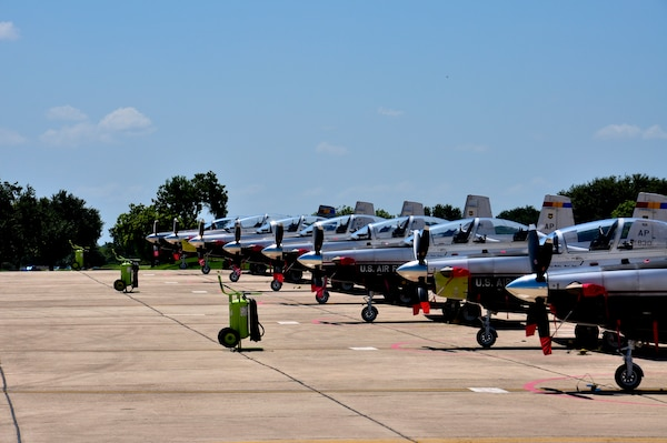 A line of T-6 Texan II aircraft sits on Joint Base San Antonio-Randolph's south ramp. These T-6s are used in the training of Combat Systems Officers by the 479th Flying Training Group, a geographically seperated unit of the 12th Flying Training Wing, at Naval Air Station Pensacola, Fla. The planes were flown to Randolph in anticipation of Tropical Storm Isaac.  (U.S. Air Force Photo by 2nd Lt. Keenan Kunst