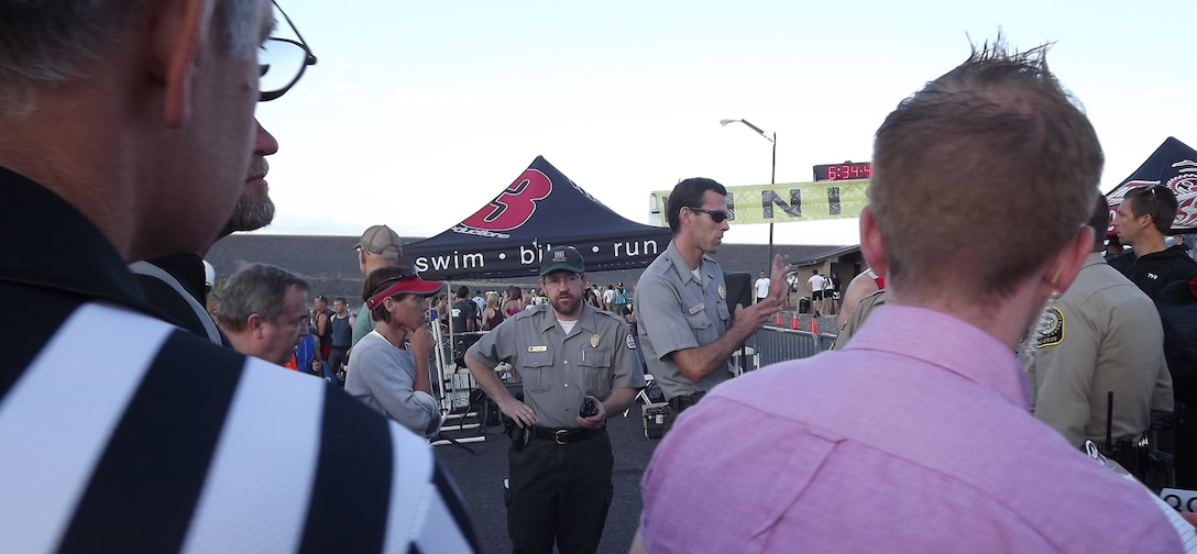 Cochiti park rangers Chris Schooley (center) and Nicholas Parks direct race participants and answer questions about the race and the Corps' Cochiti Lake project.