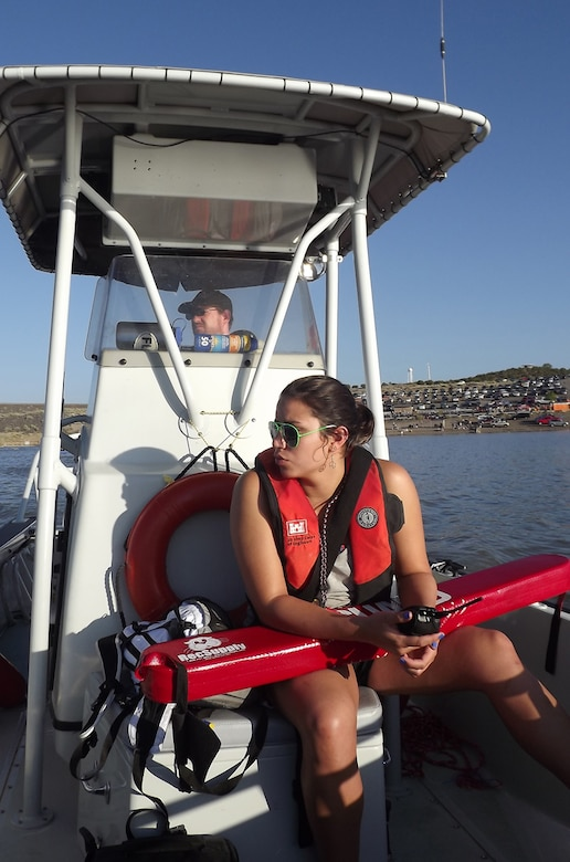 Cochiti Park Ranger Chris Schooley (driving boat) and Kelly Burggraaf, a lifeguard from UNM, stay vigilant during the swimming leg of the Cochiti Triathlon.