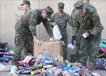 Marines with Combat Logistics Battalion 13, Combat Logistics Regiment 17, 1st Marine Logistics Group, sort toys collected during their third consecutive Toys for Tots run at Camp Pendleton, Calif., Dec. 16. The purpose of the run is to collect toys and give hope to those who may not have hope.