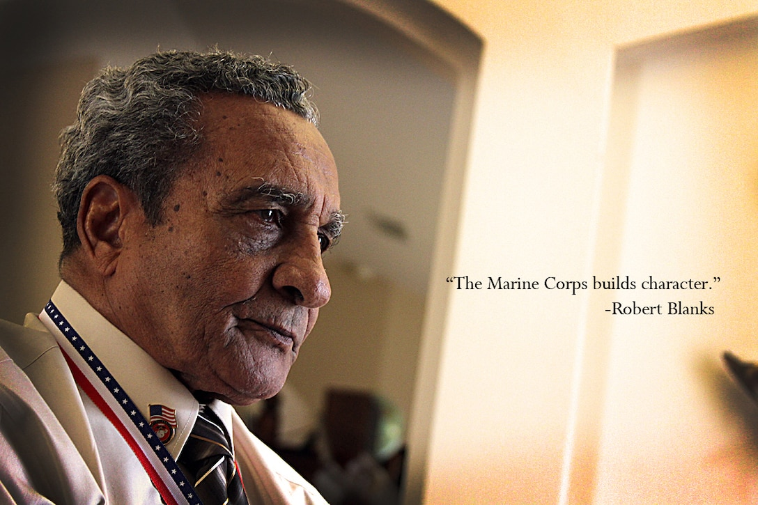 """ORANGE CITY, Florida (August 25, 2012)—""""The Marine Corps builds character,"""" said Mr. Robert Blanks, an Original Montford Point Marine. Blanks received the Congressional Gold Medal in a ceremony held at his residence. Blanks, 85, who enlisted into the Marine Corps during World War II from Bronx, N.Y., welcomed the award in recognition of his service to the nation at a time when racial discrimination was normal and the military services were just beginning to desegregate. Between 1942 and 1949, there were 19, 168 African American recruits at Montford Point, N.C., near Camp Lejeune. Of those Marines, over 13,000 served overseas during the war. Most were assigned to ammunition and depot companies bringing ammunition and supplies to the front lines and transporting wounded and dead Marines back to the beaches. The Congressional Gold Medal is the nation's highest civilian honor given by congress for distinguished achievement. The President of the United States signed into law the legislation to award the medal to the Montford Point Marines on November 23, 2011. (Official USMC photo by Staff Sgt. Tracie G. Kessler)(Released)."""