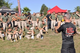 Joe A. Artino, the fitness programs supervisor at Marine Corps Community Services Camp Pendleton Semper Fit Division, gives Marines a brief before starting the Tacticle Athlete Challenge at Camp Pendleton's Paige Fieldhouse, Aug.28.