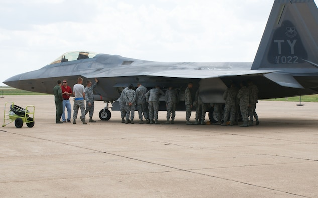 Students from the 363rd Training Squadron get armament familiarization training on the F-22 Raptor from 325th Aircraft Maintenance Squadron personnel Aug. 28, 2012 at Sheppard Air Force Base, Texas.  The 82nd Training Wing and 80th Flying Training Wing assisted in bedding down 14 aircraft and 40 personnel after their evacuation from Tyndall Air Force Base, Fla., due to Hurricane Issac.  (U.S. Air Force photo/Dan Hawkins)