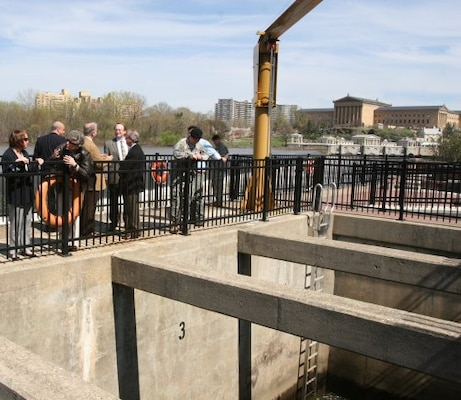 Project Manager Terry Fowler, U.S. Army Corps of Engineers' Philadelphia District, discusses the Fairmount Dam Fish Ladder project with Assistant Secretary of Army for Civil Works Jo-Ellen Darcy. The project included rebuilding the fish passage to improve its functionality.