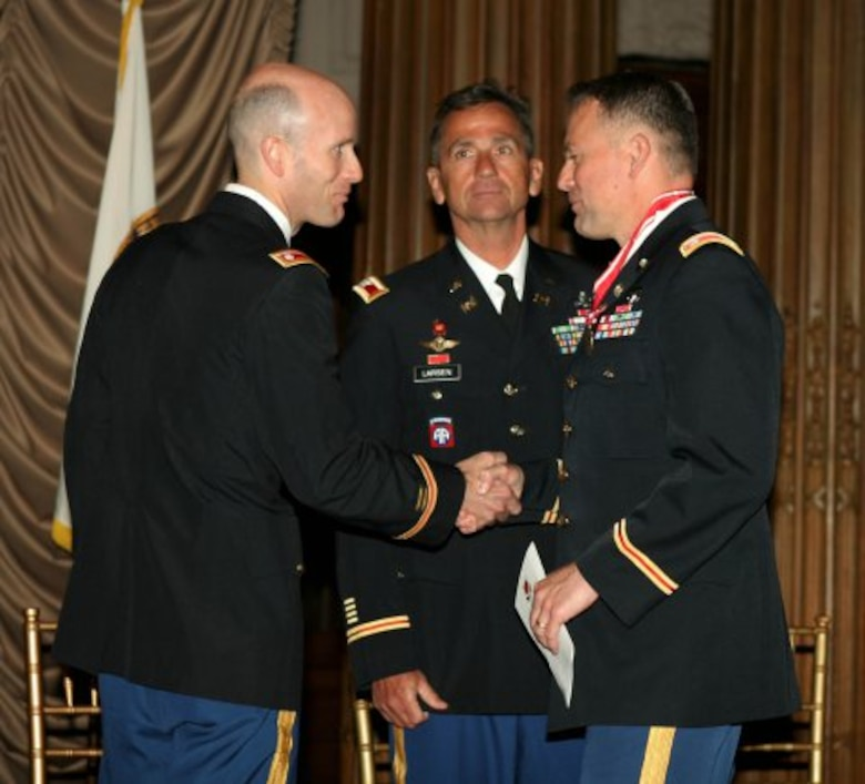 Philadelphia District Commander Lt. Col. Chris Becking (left) thanks outgoing commander Lt. Col. Philip Secrist (right) during the Change of Command ceremony June 26th. North Atlantic Division Commander Christopher J. Larsen (center) presided over the ceremony.