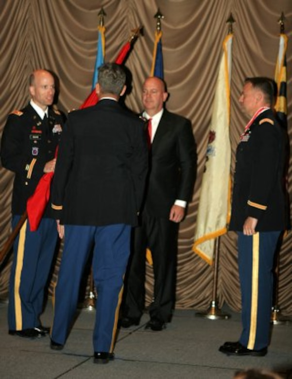 Philadelphia District Commander Lt. Col. Chris Becking accepts the colors from North Atlantic Division Commander Col. Christopher J. Larsen during a June 26th Change of Command ceremony. Outgoing commander Lt. Col. Phillip Secrist and Deputy for Program Management Curt Heckelman watch the exchange of the colors.