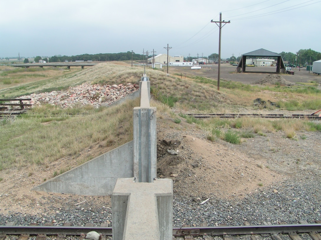 The Holly Wildhorse Creek and Arkansas River levee in Holly, Colo., east of Lamar, Colo., is one of many levees in the District's area of operations.  Its features include a railroad closure section with stop logs in place, levee with protected area to the right, and a highway bridge.