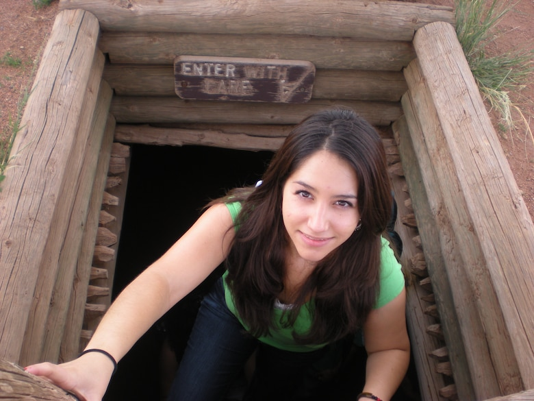 Katiana Torres ascends from a Kiva, an underground chamber used by Pueblos for religious rites, at the Pecos National Monument.