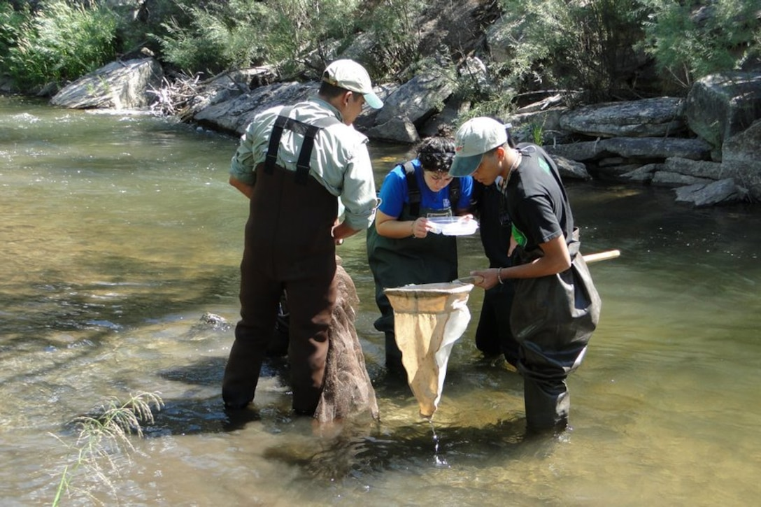 The students examined organisms found in the Pecos River at the Greer Garson Ranch.