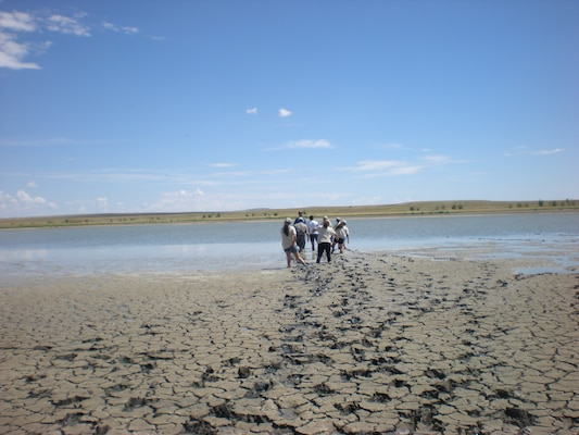 Several students get stuck in the mud during a visit to the Las Vegas National Wildlife Refuge.