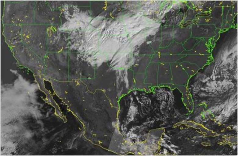 An image of the Uinited States taken by the DMSP Flight 18's Operational Linescan Sensor shows cloud cover.