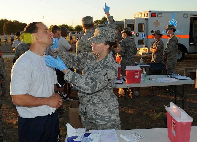 Tech. Sgt. Aaron Oelrich, receives a flu vaccine after the wing run at Beale Air Force Base, Calif., Aug. 30, 2012. Flu vaccines are available at the immunizations office in the clinic. No appointment necessary, call 634-4740 for duty hours and more information. (U.S. Air Force photo by Sean Bhakata)
