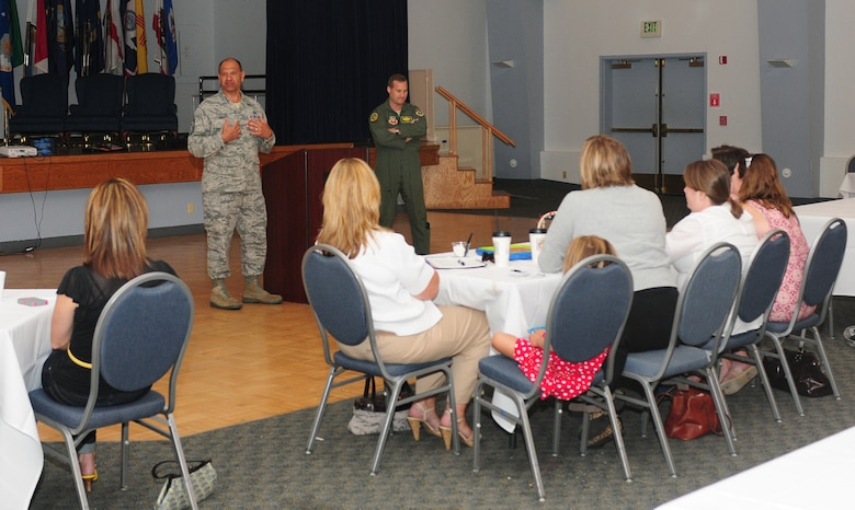 Chief Master Sgt. Robert White, 9th Reconnaissance Wing command chief, speaks with members of Beale's key spouse program at the Community Activity Center Beale Air Force Base, Calif., August 29, 2012. The spouse program offers dependents information on base agencies and the military life style. (U.S. Air Force photo by Senior Airman Allen Pollard)