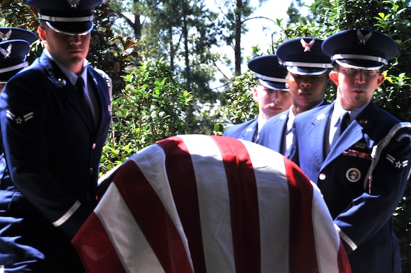 Airmen from Maxwell Air Force Base Honor Guard carry a casket during a funeral at Alabama National Cemetery, August 22. Maxwell' base honor guard supports requests throughout Alabama and parts of Georgia. (U.S. Air Force photo by Airman 1st Class William Blankenship)