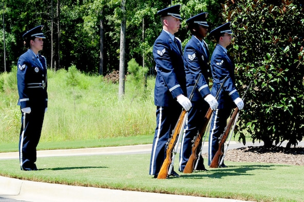 Members of the Maxwell Air Force Base Honor Guard perform a memorial ceremony held Aug. 22, 2012 at the Alabama National Cemetary in Montevello, Ala. (U.S. Air Force by Master Sgt. Michael Voss)