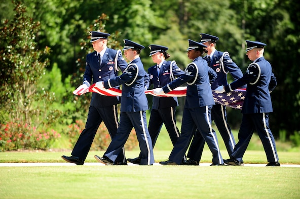 Members of the Maxwell Air Force Base Honor Guard perform a memorial ceremony held Aug. 22, 2012 at the Alabama National Cemetary in Montevallo Ala. Although Mr. was U.S. Naval veteran, Honor Guard Airmen participate in joint service funerals around the globe. (U.S. Air Force photo by Master Sgt. Michael Voss)
