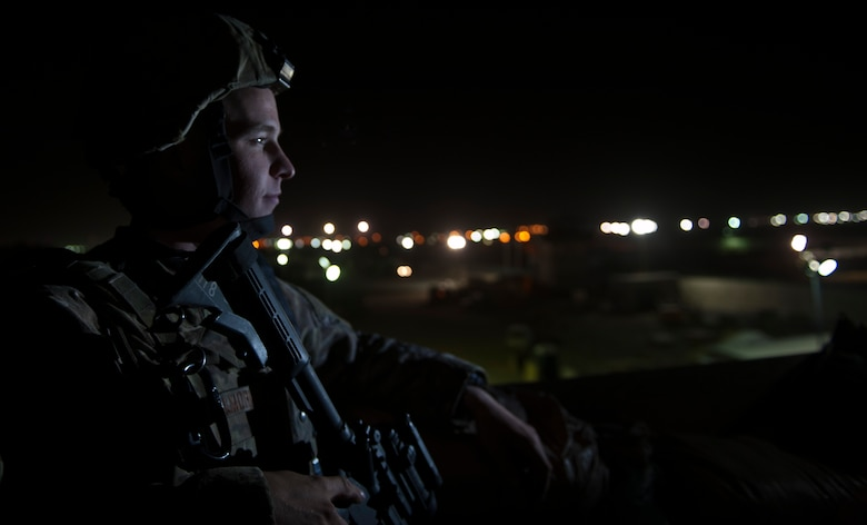 An Airman deployed with the 455th Expeditionary Security Forces Squadron monitors an entry control point at Bagram Airfield Afghanistan, Aug. 24, 2012. Bagram's large size and vital mission make it a strategic target for insurgents seeking to demonstrate capability, which is why the Airmen from 455 ESFS remain ever-vigilant against the threat of enemy attacks. (U.S. Air Force Photo/Capt. Raymond Geoffroy)