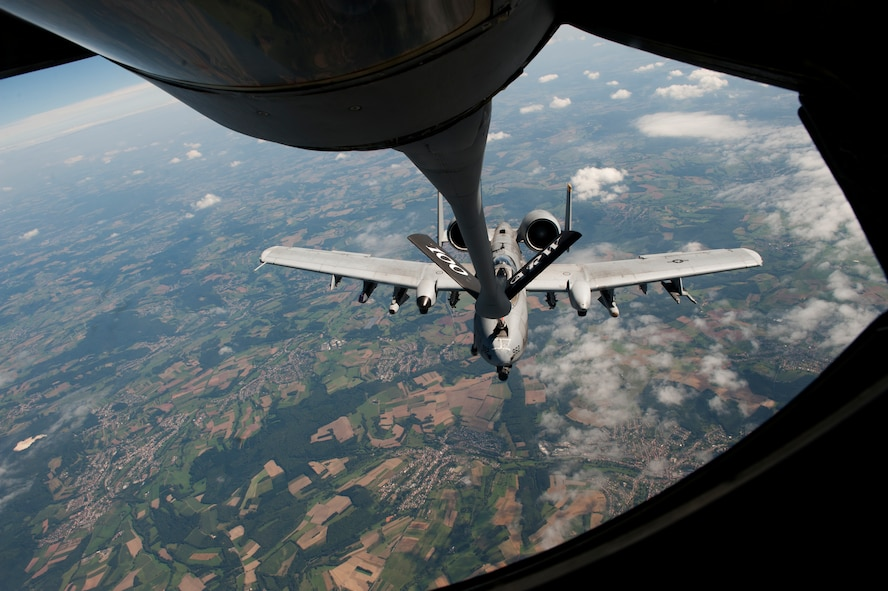 SPANGDAHLEM AIR BASE, Germany – An 81st Fighter Squadron A-10 Thunderbolt II receives fuel here Aug. 30 from a 351st Air Refueling Squadron KC-135 Stratotanker from Royal Air Force Mildenhall, England, during an orientation flight for 52nd Fighter Wing spouses. The flight allowed spouses to get an up-close view of 81st FS aircraft from Spangdahlem AB during in-flight refueling. The 351st ARS and 52nd FW aircrew train together to enhance their interoperability to perform in-flight refueling missions. (U.S. Air Force photo by Airman 1st Class Dillon Davis/Released)