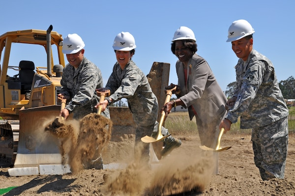 Col. Jed Davis, 30th Mission Support Group commander, Col. Nina Armagno, 30th Space Wing commander, Barbara Bennie, Force Development Flight chief, and Col. Mark Toy, Los Angeles District commander turn over shovels of dirt as part of the official groundbreaking for the Vandenberg Air Force Base education center Aug. 15.  The $14.2 million building will replace a 60-year-old facility that is used by more than 3,000 Airmen and their families.