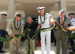 APCSS Director, retired U.S. Air Force Lt. Gen. Dan Leaf, left; U.S. Senator Daniel Inouye; Admiral Samuel J. Locklear III, U.S. Pacific Command; and Peter F. Verga representing the Office of the Secretary of Defense for Policy untie the maile lei during the official opening of Maluhia Hall, a new state-of-the-art learning center, at the Asia-Pacific Center for Security Studies on August 24, 2012. The $11.4 million learning center brings more than 10,000 sq ft of additional classroom space to support U.S. Department of Defense institute's security cooperation and executive education programs.