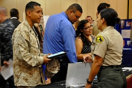 A Marine discusses career options with a San Diego County Sheriff during The Patriot Group Inc. job fair at the Pacific Views Event Center on Marine Corps Base Camp Pendleton, Aug. 30.