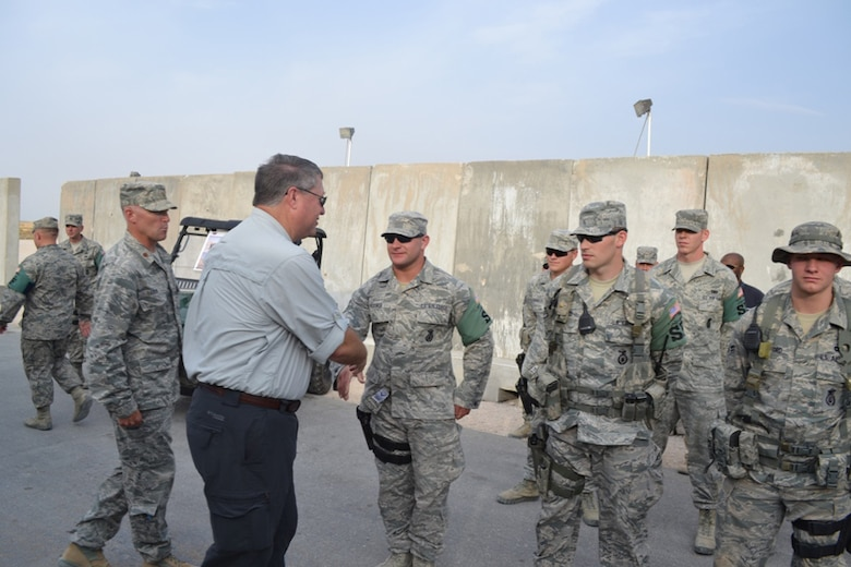 SOUTHWEST ASIA – Secretary of the Air Force Michael B. Donley visits with members of the South Dakota Air National Guard's 114th Security Forces Squadron during a recent visit to Southwest Asia Aug. 24, 2012.  The 114th SFS, based out of Joe Foss Field in Sioux Falls, S.D., has been deployed since April and has been providing law enforcement, troop escort and security work within a base in Southwest Asia. (U.S. Air Force photo by 405th Expeditionary Security Forces Squadron) (RELEASED)