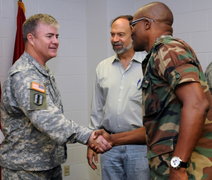 RAPID CITY, S.D. - Brig. Gen. Jeff Marlette (left), assistant adjutant general of the South Dakota Army National Guard, welcomes Col. Hedwig Gilaard, Suriname Chief of Armed Forces, to Camp Rapid in Rapid City, S.D., as U.S. Ambassador to Suriname Mr. John Nay looks on Wednesday, June 15, 2011. The dignitaries were shown various military training associated with the annual Golden Coyote training exercise, which brought 2,100 National Guard Soldiers and Airmen from across the U.S. to the Black Hills for the two-week training event. (SDNG photo by OC Chad Carlson) (RELEASED)