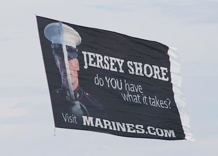 A Marines advertising banner flies over the Jersey Shore encouraging prospects on the beach to visit www.Marines.com.