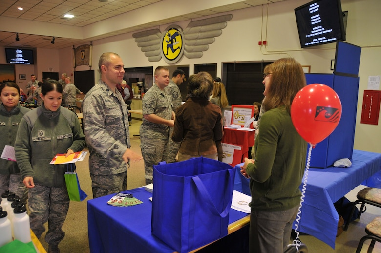 Members of the Connecticut Air National Guard check out the displays and information booths for charities during the annual Combined Federal Campaign kick-off event hosted by the 103rd Airlift Wing at Bradley Air National Guard Base, East Granby, Conn., Nov. 14, 2012. (U.S. Air Force photo by Senior Airman Emmanuel Santiago)